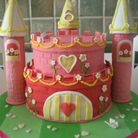 Pink Princess Castle Castle cake made for a 6 year olds birthday. Vanilla cake and vanilla buttercream with lots of pink fondant!