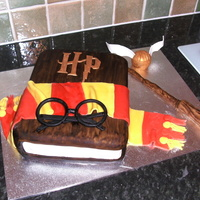 Harry Potter Cake Harry Potter cake made from chocolate cake and decorated all in fondant. The wand and snitch are rice krispie treats.