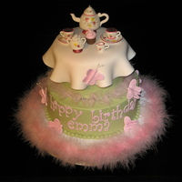 Tea Party Cake This tea party themed cake was created for a little girl's 4th birthday. The green is buttercream and the top tier 'tablecloth&#...