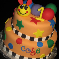 Baby Einstein Caterpillar Cake Created for a first birthday inspired by the Baby Einstein Caterpillar. Decor is fondant.