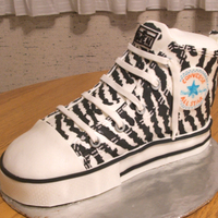 Zebra Print Chuck Taylor  This was made for my 12 year old step-daughter's birthday. The zebra print is inlayed MM fondant. The stitching is piped royal icing...