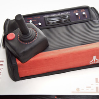 Atari 2600 Cake Atari 2600 and joystick cake made for a friends 40th birthday.Chocolate sponge with vanilla cream, control panel and game graphics drawn in...