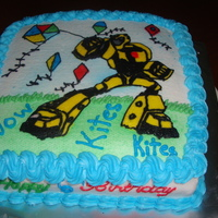 Kite And Transformers Birthday Cake Cake done for a 6 year old boy who like Kites and Transformers so a cake had to be done to incorporate both. All buttercream decoration.