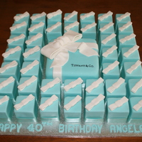 Tiffany Box Cake With Smaller Matching Cakes  White chocolate mud cake covered in Tiffany blue coloured pettinice to resemble a Tiffany & Co jewel box. White bows on top are...