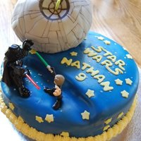 Star Wars Deathstar Birthday Cake Star Wars birthday cake covered in fondant. Death Star is a round cake made using the Wilton ball pan and covered in fondant, decorated...