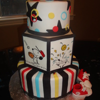 Snoopy Sports Baby Shower This is a cake for a Snoopy Sports themed baby shower. Mom wanted something to keep, so the painted tier is a dummy. Red Velvet cake with...
