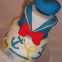 Donald Duck 1St Birthday This is the birthday cake I made for my youngest son's 1st birthday. PB and J cake covered with fondant, hat sculpted out of cake. TFL...