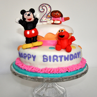 Elmo, Dora And Mickey Fondant Cake My third fondant cake for my daughters 2nd birthday. I couldn't decide on a theme so I went with all the different characters she...