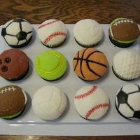 Sports Ball Cupcakes Made for a little boy who was having a sports themed party. Half chocolate and half vanilla WASC with MMF tops.