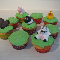 Farm Animal Cup Cakes   Vanilla cup cakes, butter cream grass, fondant animals