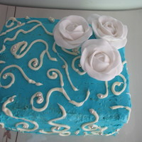 Blue Cake With White Roses   Butter cream icing (will use fondant next time!!) and moulded fondant roses