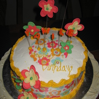 Flower Power Buttercream with fondant accents and edible paper. Chocolate cake with fresh strawberries N cream filling.