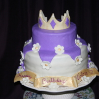 Princess Victoria This was my first 2 tier cake. I made it for my grand daughters first birthday. I used MMF to cover the cake, the flowers and the crown. I...