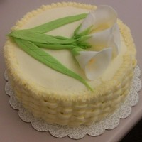 Calla Lillies Hummingbird cake with calla lillies and butter/cream cheese frosting in basketweave.