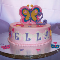 Butterflies & Dragonflies Yellow cake, chocolate BC filling, BC, MMF decorations.