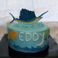 Deep Sea Fishing Chocolate cake with chocolate filling, BC, all decor made from MMF. Fish are painted with edible paint.