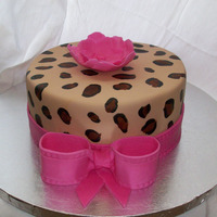 Leopard Cake I made this for my own birthday! Chocolate cake, Nutella BC filling, Chocolate ganache, MMF, flower, ribbon & bow made from MMF &...