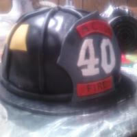 Firemans Helmet First attempt @ 3D cake. Carrot cake covered baked in a pyrex bowl and round layer. Covered in thin layer of creamcheese and then in MMF....