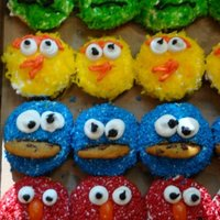Sesame Street Cupcakes These were for my nephews 1st birthday. Yellow cake with buttercream frosting. Elmo & Cookie Monster are sprinkles, Oscar & Big...