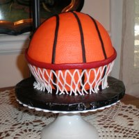 Basketball Cake  This cake traveled from Coweta County, GA to Elgin Illinois, and made it in tact! This was for my nephew's birthday. I also traveled...