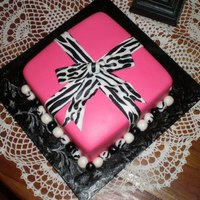 Hot Pink With Zebra Print Bow Gift Box This was made for a 14-year-old girl's birthday. Her mother said she was too old for a purse cake. It wasn't my place to tell her...