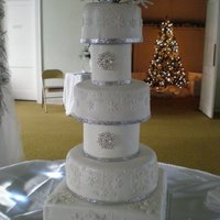 Winte Wonderland Wedding Cake  They asked for big, and they asked for a winter wonderland shimmery snowflake look. It was my first time using styrofoam spacers. 12 inch...