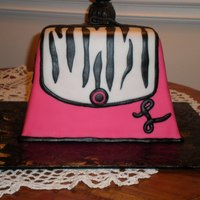 First Purse Cake   This was my first, and I had a blast making it! TFL