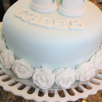 "Blue Cake With Fondant Shoes And White Roses My finale cake for class. Using tip #12 and#104. The Wilton Rose. First Fondant Shoes. 8"" round 2 Layer cake. Marble Cake and..."