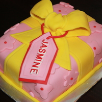 Yellow And Pink Gift Box My second fondant cake. First rectangular shape. First giftbox. First fondant bow. First gift tag. First one I made as a gift. Chocolate...