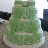 Green & White 3 Tier Cake   yellow cake w/ vanilla custard filling.Covered in fondant swirls done w/ bc added a little bling on bow. TFL