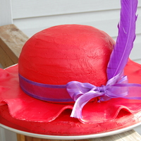 "Red Hat Society Cake  The top of the hat is an orange pineapple cake baked in a pyrex bowl - on top of an 8"" round for height. Under the fondant brim is a..."