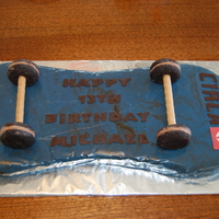 Skateboard Cake   My first fondant figure cake! The logo and lettering was made from chocolate.