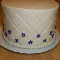 Quilted Cake 6 inch vanilla buttermilk cake filled blueberry jam. Iced in vanilla buttercream.Decorated with royal icing flowers. My first time using an...