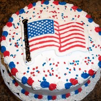 Memorial Day Cake chocolate fudge chocolate chip cake with cookies and cream mousse filling and whipped cream icing, topped with an fbct flag