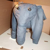 3D Elephant  This was my first ever 3d carved style cake, i made a wooden platform with legs as my base, covered the legs and made the head/trunk out of...