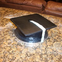 Graduation Cap For My Baby Girl Leaving Preschool   Strawberry cake butter cream filling covered in satin ice black fondant and blue tasselfor my 5 year old daughter leaving preschool