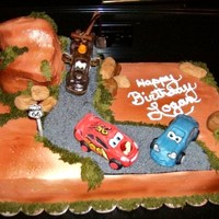 Disney Pixar's Cars This is my favorite cake to date. This cake took on a life of it's own. The base and mountain are made from yellow cake and frosted...