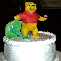 "Pooh Bear, First Birthday The cake is a 6"" round, frosted with butter cream. Pooh is made of modeling chocolate, Little butterfly, and umbrella, also made from..."