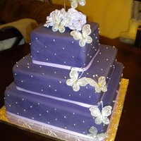 Purple Butterfly Cake The bride wanted a deep purple and butterflies. I was a little worried about if it would all work together, but she loved it.