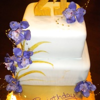 Natural Birthday Cake Made for a coworker, with purple flowers, gold accents, and a baby green fondant