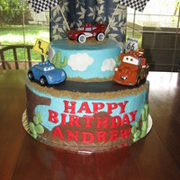Cars Birthday Cake This was my first stacked cake, for my son's 2nd birthday. It is buttercream, with fondant decorations (first time working with...