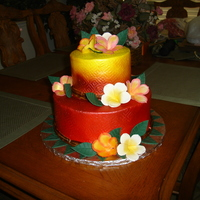 Hawaiian Bridal Shower Cake  I made this cake for a friend. The cake was a pina colada cake with a vanilla mousse frosted in butter cream with gum paste flowers and a...