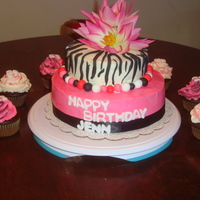 Hot Pink And Zebra Pattern Birthday Cake Bottom tier is four layers of vanilla flavored cake with pineapple-cream cheese filling. Top tier is chocolate cake. Both tiers are covered...