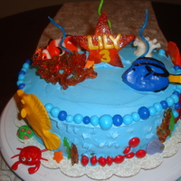 Reef Cake Reef cake made for my daughter's 3 month birthday. All fish, corals and decorations made from fondant. 1 coral on top made from...