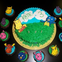 Backyardigans Birthday Cake And Cupcakes For my daughters 3rd Birthday!! First time doing the color flow technique.Covered in buttercream. Clouds and flowers are fondant.