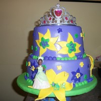 Princess And The Frog Birthday Cake Princess and the frog cake for a 3 year old birthday. MMF over buttercream. Fondant and Royal Icing accents. Plastic crown, pricess, and...