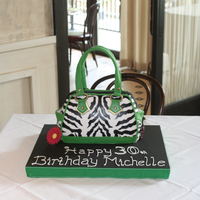 Michelle's 30Th Zebra Print Hand Bag Life size, hand painted zebra print hand bag. Modeling Chocolate Handles, and handmade charms and daisy.