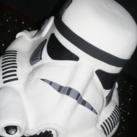 "Stormtrooper Helmet Cake 15"" tall 18"" long, chocolate cake with chocolate ganache, Face Guard made from rice cereal! White piping dots on base really..."