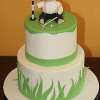 Golf Tournament Baby Shower Smooth Buttercream cake, Vanilla cake with strawberry bc filling. Fondant decorations, and hand sculpted baby in golf attire. Baby made...