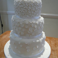 Ivory Blossom Wedding Cake (My First Ever Wedding Cake!) Three tiered lemon sponge with lemon buttercream.Covered in ivory sugarpaste with shimmer dusted white flowerpaste blossoms. Used two...